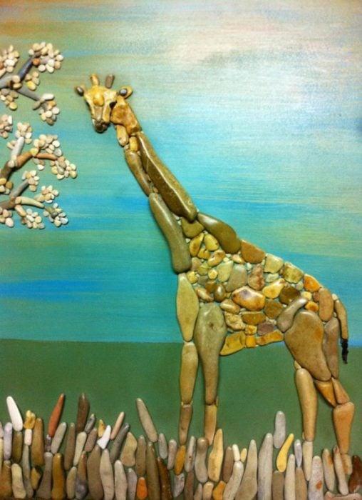 jirafa hecha con piedras