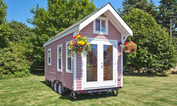 acogedora casa rodante pequeña color rosa