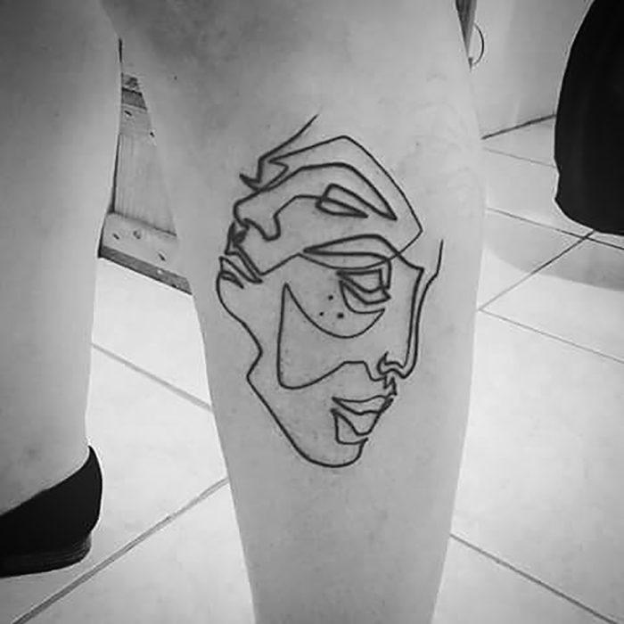 tatuaje de una sola línea de doblecara