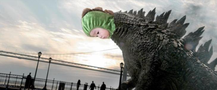 Niño dinosaurio asomándose