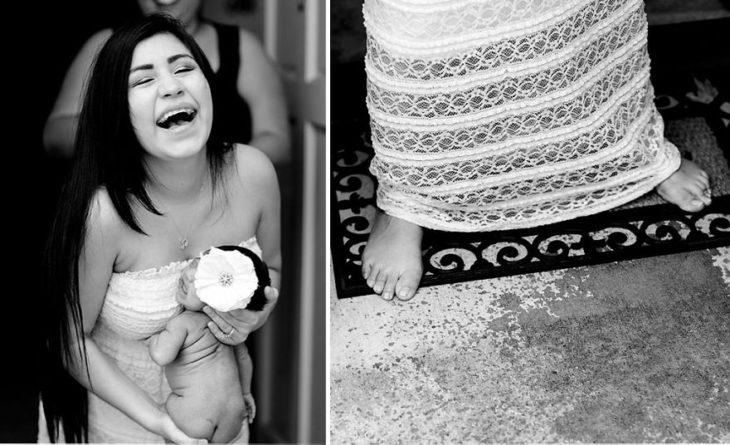 mujer cargando a bebpe que se hace pipí en su vestido