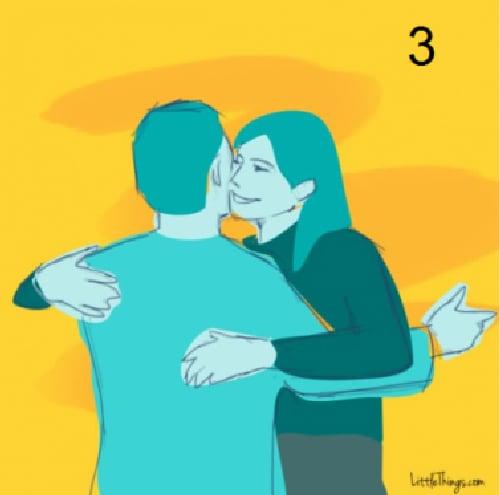abrazo con beso en mejilla