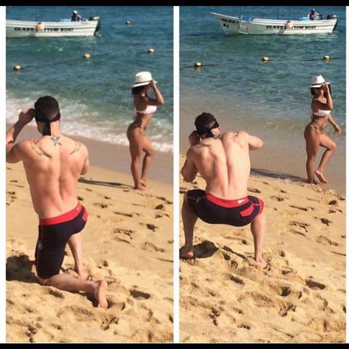 hombre en la playa tomando fotos de su novia