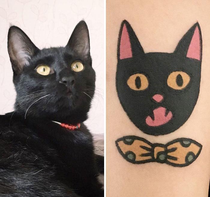 gato negro moño amarillo tatuaje