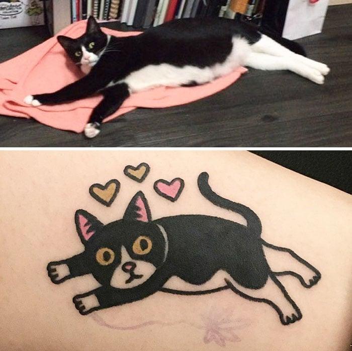 gato negro acostado tatuajes