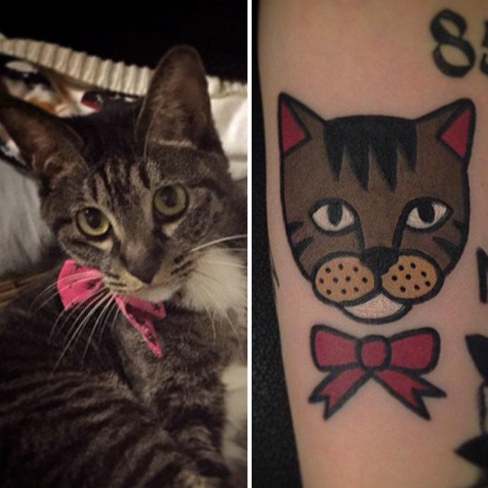 gato con moño rojo tatuaje