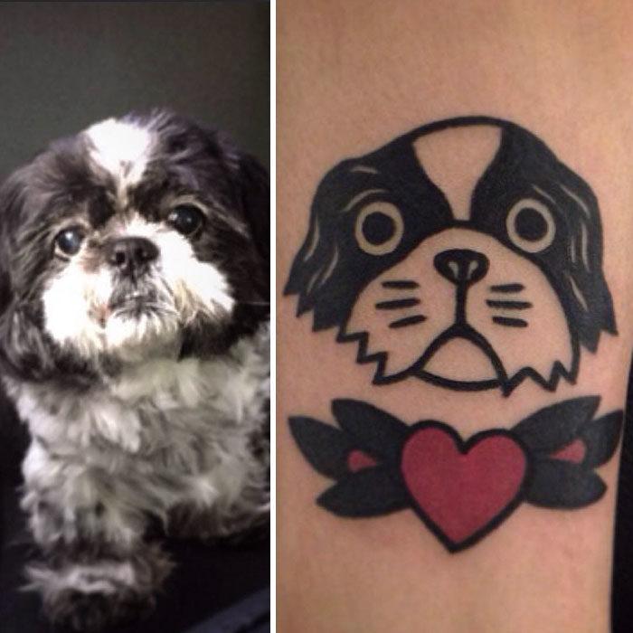 perro blanco con negro tatuaje