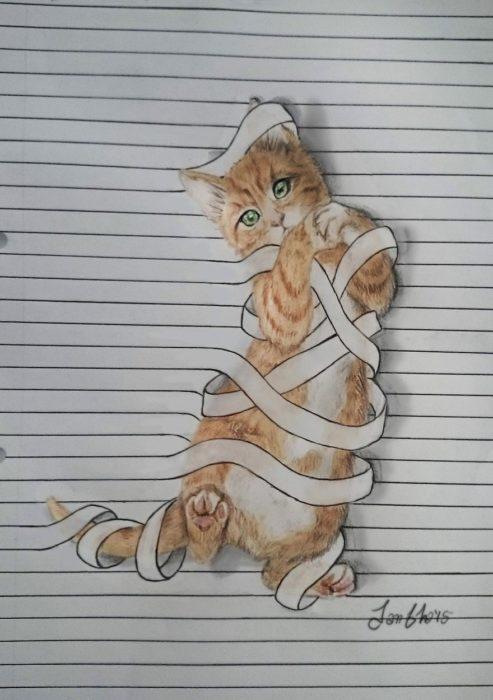 dibujo gato en libreta