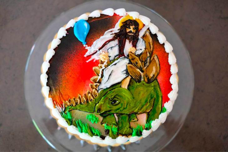 pastel de jesús montado en un dinosaurio