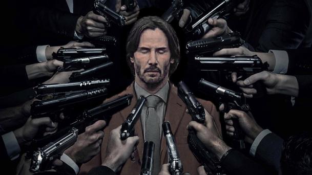 Batalla PS Keanu Reeves rodeado de pistolas
