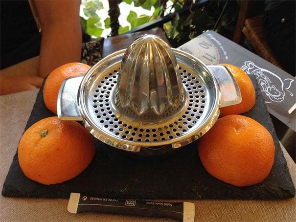 naranjas y exprimidor