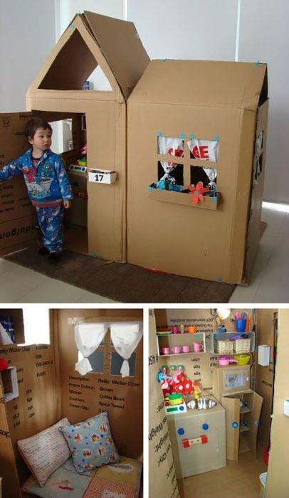 niño en una casa de cartón