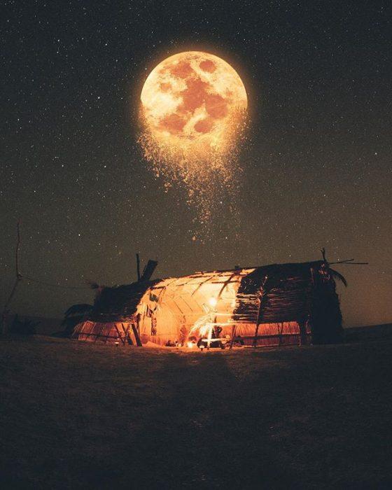 paisaje con luna desintegrándose
