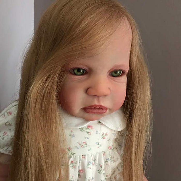 muñeca realista fea