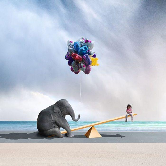 elefante y niña en un sube y baja