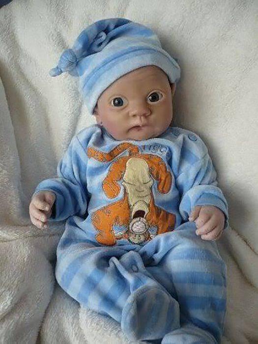 muñeco reborn con ojos saltones