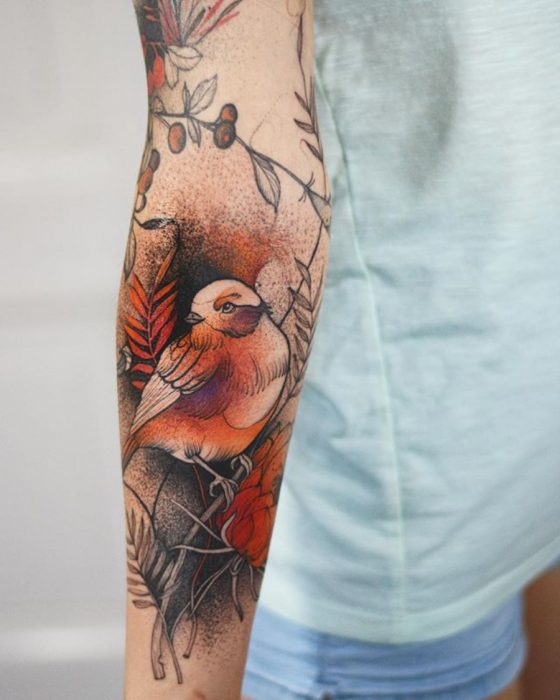 tatuaje de pájaro carmín